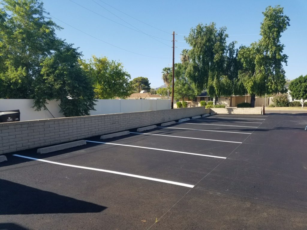 Parking lot striping and bumper curb Phoenix AZ